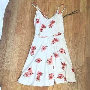 White floral dress with crossed back.